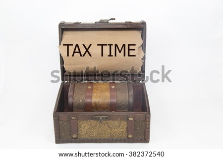 tax time is written on the Brown torn paper in the treasure box. isolated on white background - stock photo