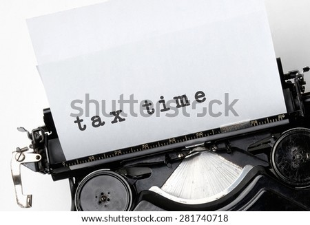 Tax time  printed on retro typewriter. Space for text - stock photo