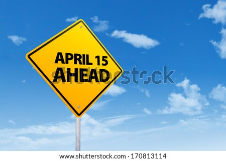 Tax time reminder concept with a road sign of the day tax april 15 - stock photo