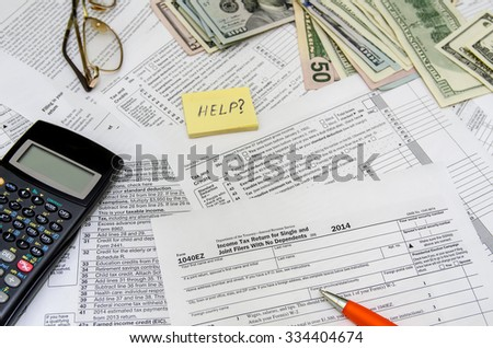 taxation concept: form with calculator, money, pen