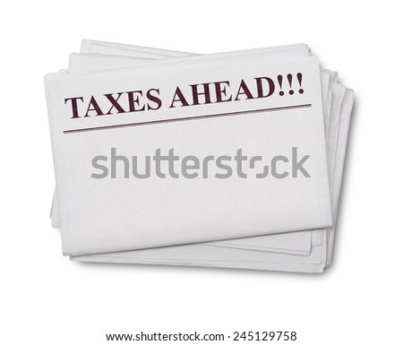 Taxes ahead title on a newspaper
