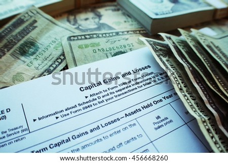 Taxes ( Gains & losses ) Stock Photo High Quality