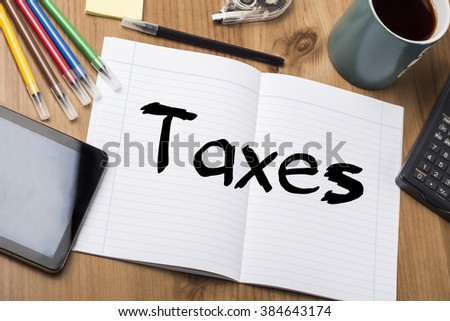 Taxes - Note Pad With Text On Wooden Table - with office  tools