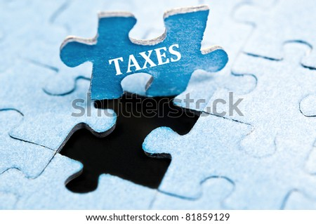 Taxes piece of puzzle stand up - stock photo