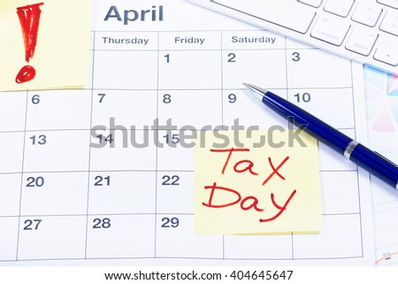 Taxes. Tax Day - April, 15. Concept for tax day or april 15 the national deadline for filing taxes