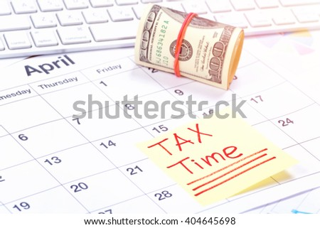 Taxes. Tax Day - April, 15. Concept for tax day or april 15 the national deadline for filing taxes - stock photo