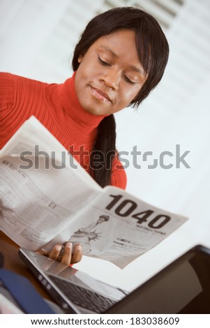 Taxes Woman Reads 1040 Instruction Booklet Stock Photo 183038609