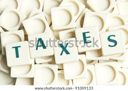 Taxes word made by leter pieces