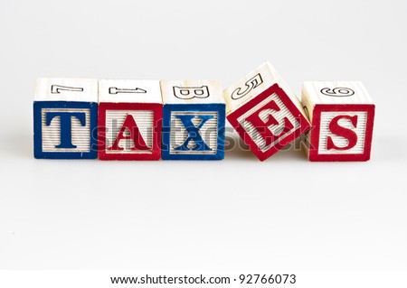 Taxes word made by letter blocks