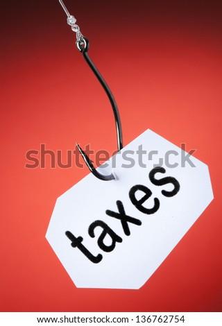 taxes word on hook - stock photo