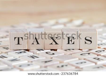 taxes word on wood blocks - stock photo