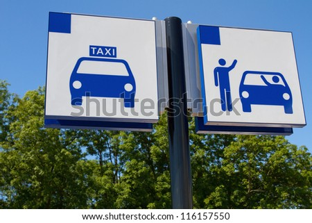 Taxi and drop off sign - stock photo