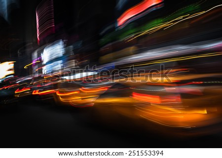 Taxi at night in New York City. Illumination and night lights of New York City. Intentional motion blur - stock photo
