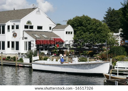 taxi boat and restaurant in Mystic, Connecticut - stock photo