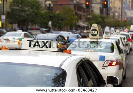 Taxi car top in a big city. - stock photo