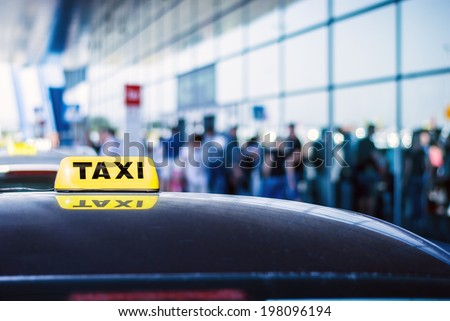 Taxi car waiting arrival passengers in front of Airport Gate - stock photo