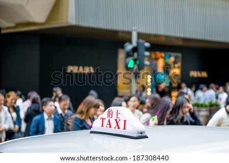 Taxi cars are waiting in row on the street - stock photo