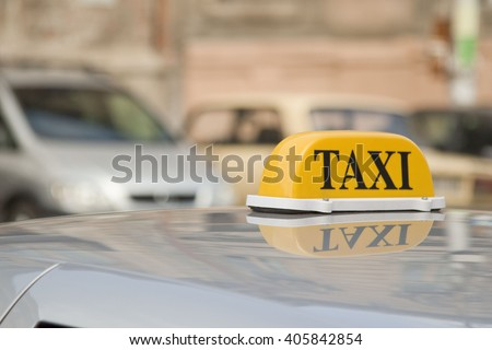 Taxi cars are waiting in row on the street
