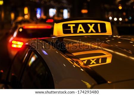 taxi cars at night - stock photo
