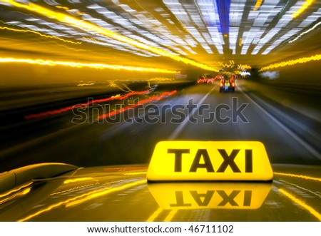 Taxi driving at high speed through the heavy traffic at night, seen from the roof of the cab - stock photo