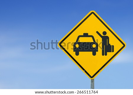 Taxi icon yellow road sign on sky background - stock photo