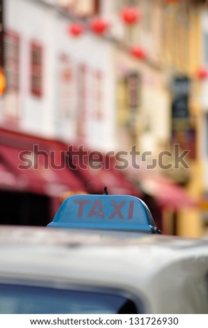 Taxi in China town, Singapore with taxi markings visible and selective focus - stock photo