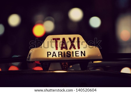Taxi in Paris - stock photo