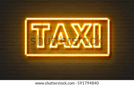 Taxi neon sign on brick wall background