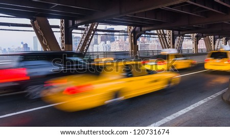 taxi on Queensboro Bridge and New York City Manhattan on background - stock photo