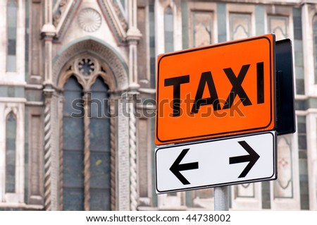 Taxi rank sign with Italian church in background - stock photo