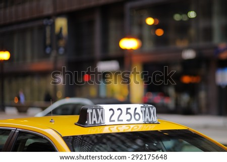Taxi sign in big city close up - stock photo