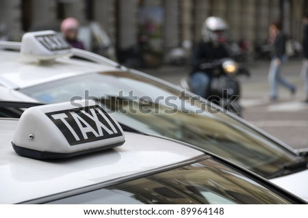 Taxi sign on a cab