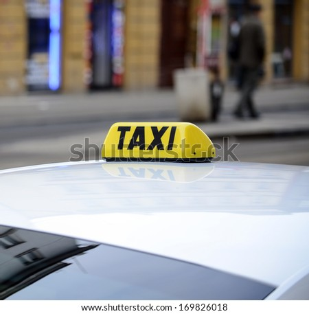 Taxi sign on car - stock photo