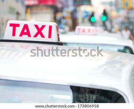 Taxi sign on the street, Hong Kong. selective focus - stock photo