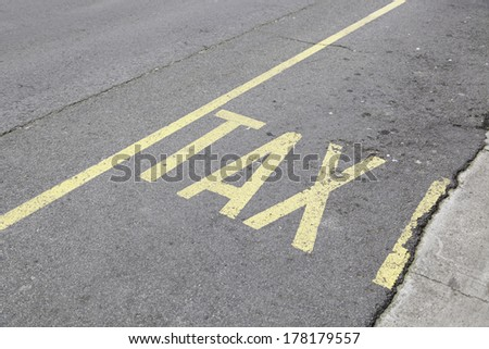 Taxi sign painted on asphalt, detailed information signal on the road, public transport