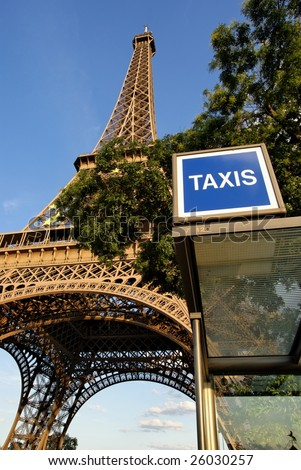 Taxi stand at the bottom of the Eiffel Tower in Paris, France - stock photo