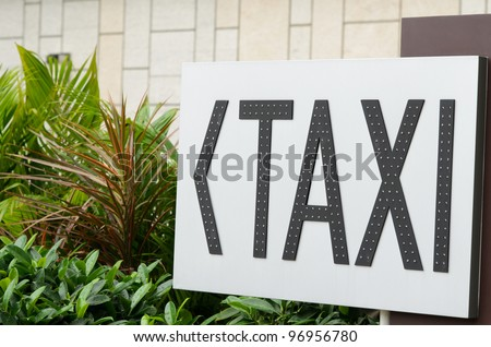Taxi stand sign on garden background - stock photo