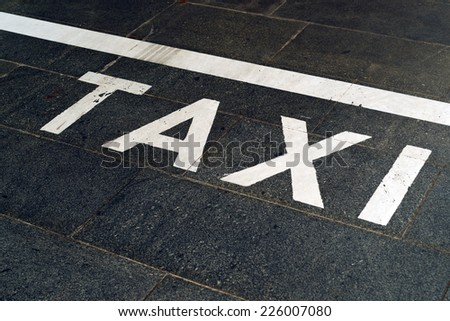 Taxi Stand Sign on the road with selective focus - stock photo