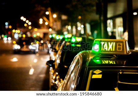 taxi waiting line in a city at night