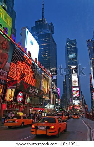 Taxis and Time Square at twilight