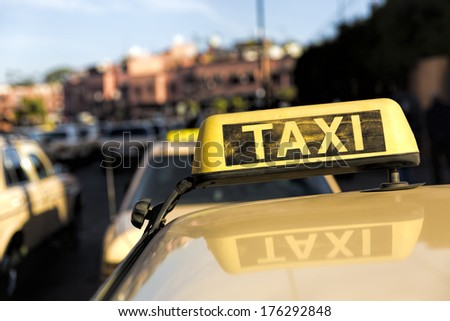 Taxis in a Moroccan town, North Africa - stock photo