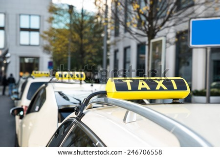 Taxis Parked Behind The Other At A Taxi Rank - stock photo