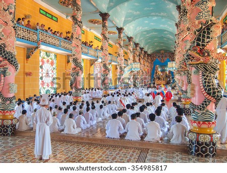 TAY NINH, VIETNAM - MARCH 3, Meditating followers of the Cao Dai religion in the temple Cao Dai on MARCH 3, 2013