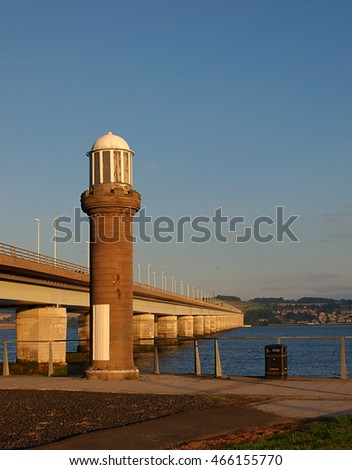 Tay Road Bridge. Dundee, Scotland - September 07, 2013 Lighthouse and bridge Road Bridge over the River Tay in the Scottish city of Dundee.