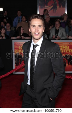 "Taylor Kitisch at the ""John Carter"" Los Angeles Premiere, Regal Cinemas, Los Angeles, CA 02-22-12 - stock photo"