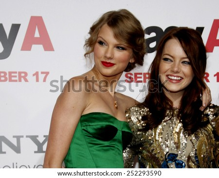 """Taylor Swift and Emma Stone at the Los Angeles Premiere of """"Easy A"""" held at the Grauman's Chinese Theater in Hollywood, California, United States on September 13, 2010. - stock photo"""