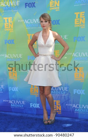 Taylor Swift arrives at the 2011 Teen Choice Awards at the Gibson Amphitheatre, Universal Studios, Hollywood. August 7, 2011  Los Angeles, CA Picture: Paul Smith / Featureflash - stock photo