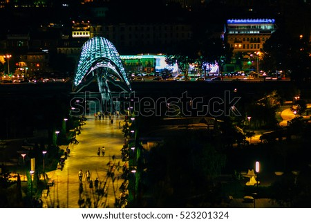 Tbilisi downtown. peace bridge made from glass, river Mtkvari. Night scene