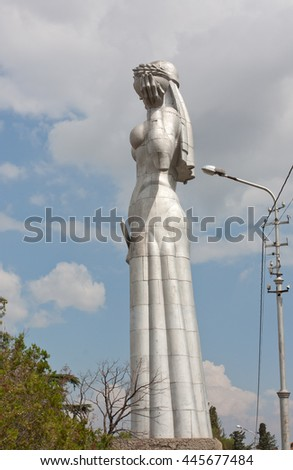 TBILISI, GEORGIA - AUGUST 08, 2013: Statue of Mother Georgia in Tbilisi, Georgia. The memorial is 50 meters high and watches over Georgia from a hill above Tbilisi. - stock photo