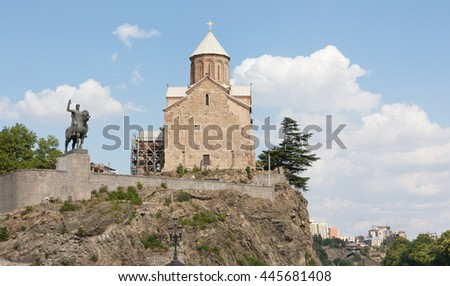 TBILISI, GEORGIA - 7 AUGUST,2013:Virgin Mary Metekhi church with Vakhtang I Gorgasali statue in Tbilisi, Georgia - stock photo